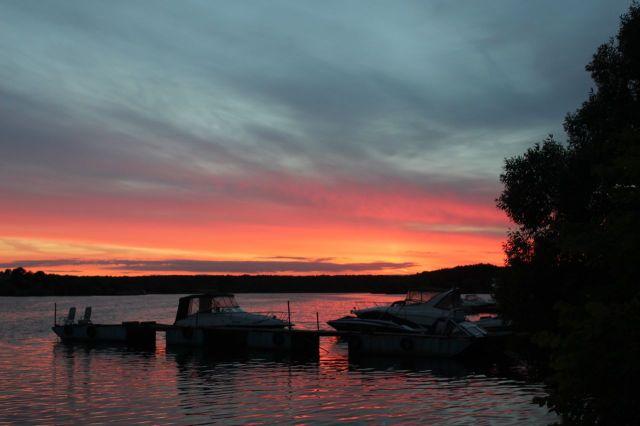Long sun sets by the lake