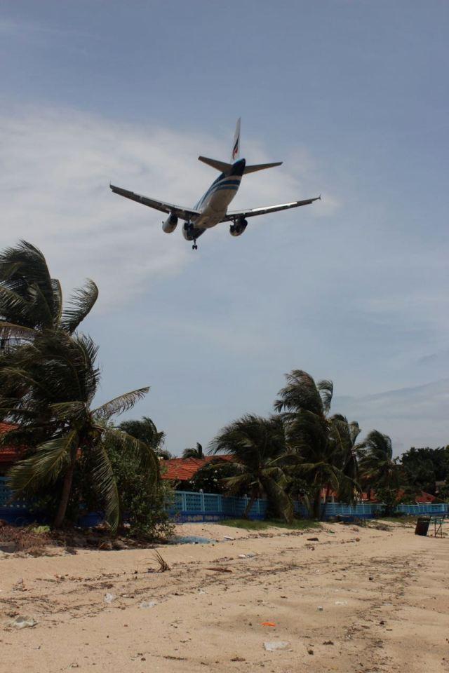 Airplane by the beach